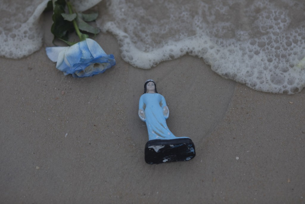 A small statue of Yemanja, goddess of the sea, is seen on the sand during a ceremony that is part of traditional New Year's celebrations on Copacabana...