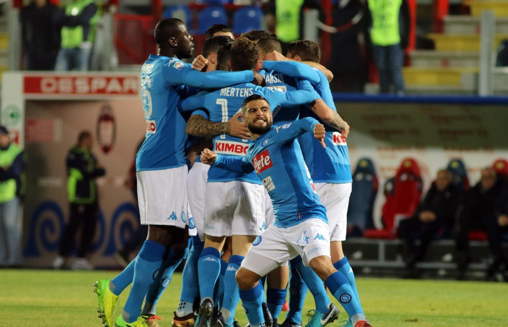 Napoli's Marek Hamsik, covered, celebrates with his teammates after scoring the opening goal during the Italian Serie A soccer match between Crotone a...