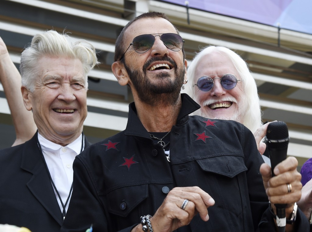 FILE - In this Friday, July 7, 2017 file photo, Ringo Starr, center, is joined by guests including filmmaker David Lynch, left, and musician Edgar Win...