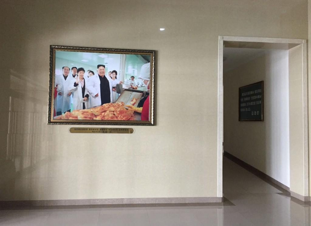 In this Dec. 20, 2017, photo, a portrait of North Korean leader Kim Jong Un is seen in the entrance way of the Ryugyong Kimchi Factory on the outskirt...
