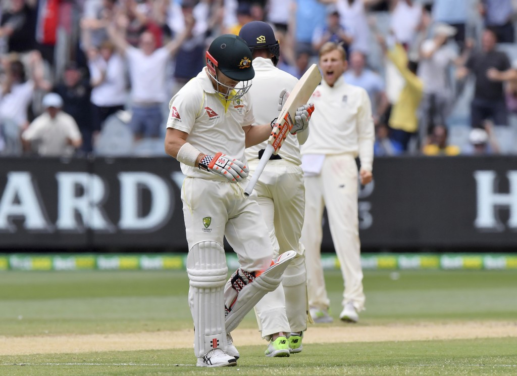 Australia's David Warner, left, walks off after he was caught out for 86 runs off the bowling of England's Joe Root during the fifth day of their Ashe...