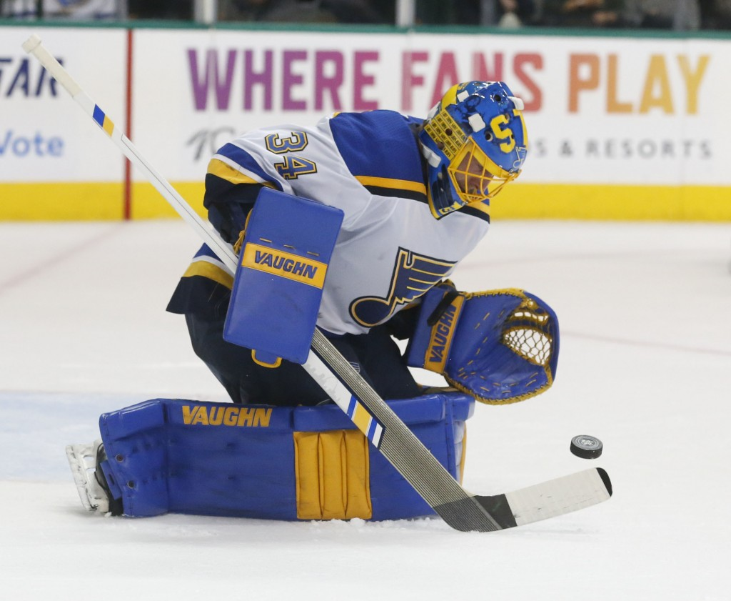 St. Louis Blues goaltender Jake Allen (34) makes a save on a shot by the Dallas Stars during the first period of an NHL hockey game in Dallas, Friday,...