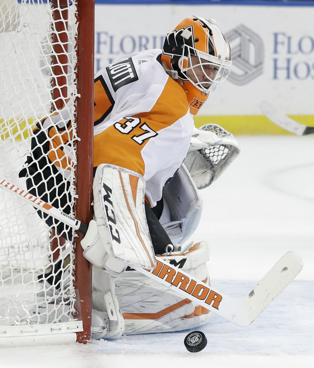 Philadelphia Flyers goaltender Brian Elliott makes a save on shot by the Tampa Bay Lightning during the second period of an NHL hockey game Friday, De...