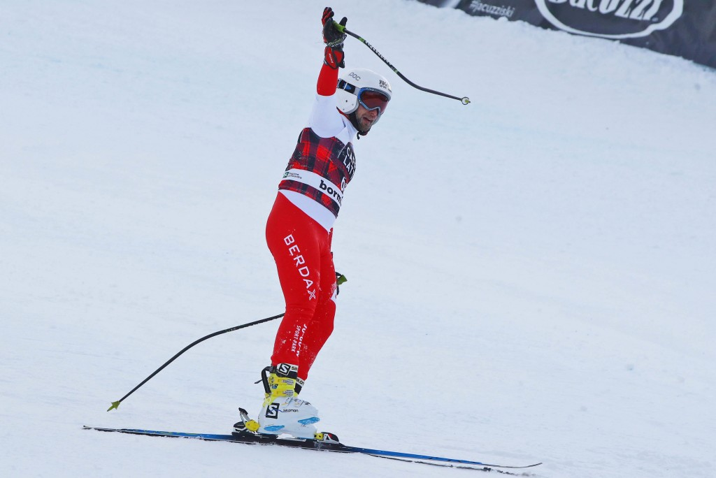 Polish skier Pawel Babicki arrives at finish line, completing the race after loosing one of his skis during the feared Stelvio downhill, in Bormio, It...