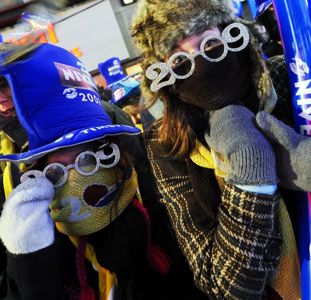 FILE- In this Dec. 31, 2008 file photo, revelers bundle up against the freezing cold at the New Year's eve festivities in New York's Time's Square. Br...