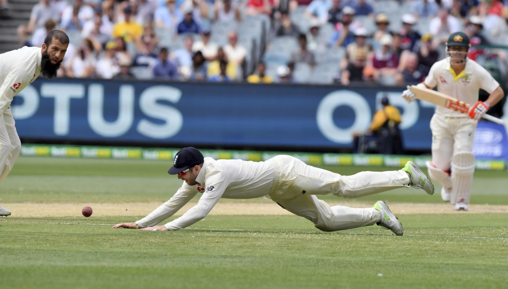 England's Mark Stoneman dives to field against Australia during the fifth day of their Ashes cricket test match in Melbourne, Australia, Saturday, Dec...