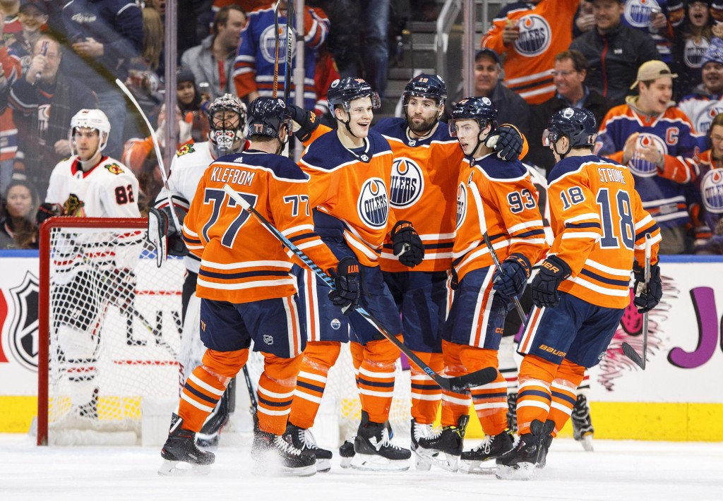 The Edmonton Oilers celebrate a goal against the Chicago Blackhawks during the first period of an NHL hockey game Friday, Dec. 29, 2017, in Edmonton, ...