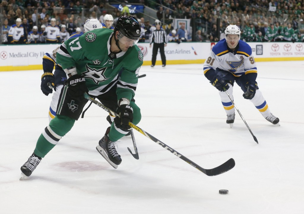 Dallas Stars right wing Alexander Radulov (47) and St. Louis Blues right wing Vladimir Tarasenko (91) chase the puck during the first period of an NHL...