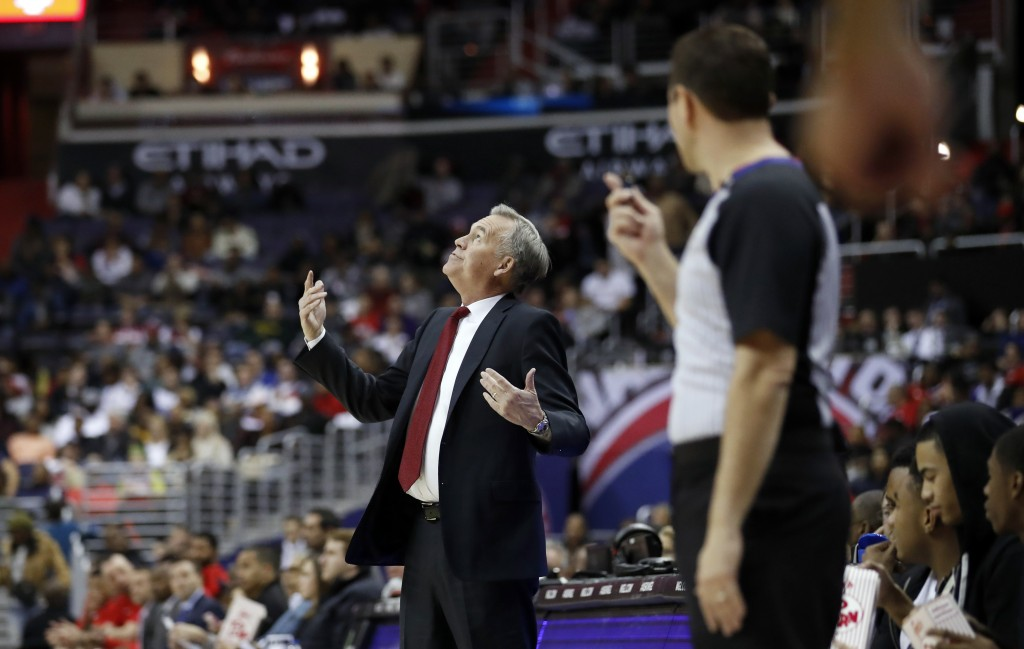 Houston Rockets coach Mike D'Antoni looks up at the monitor as he disputes a call during the first half of the team's NBA basketball game against the ...
