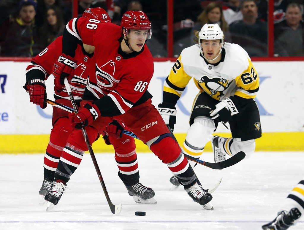 Carolina Hurricanes' Teuvo Teravainen (86) brings the puck up the ice after taking it from Pittsburgh Penguins' Carl Hagelin (62) during the second pe...