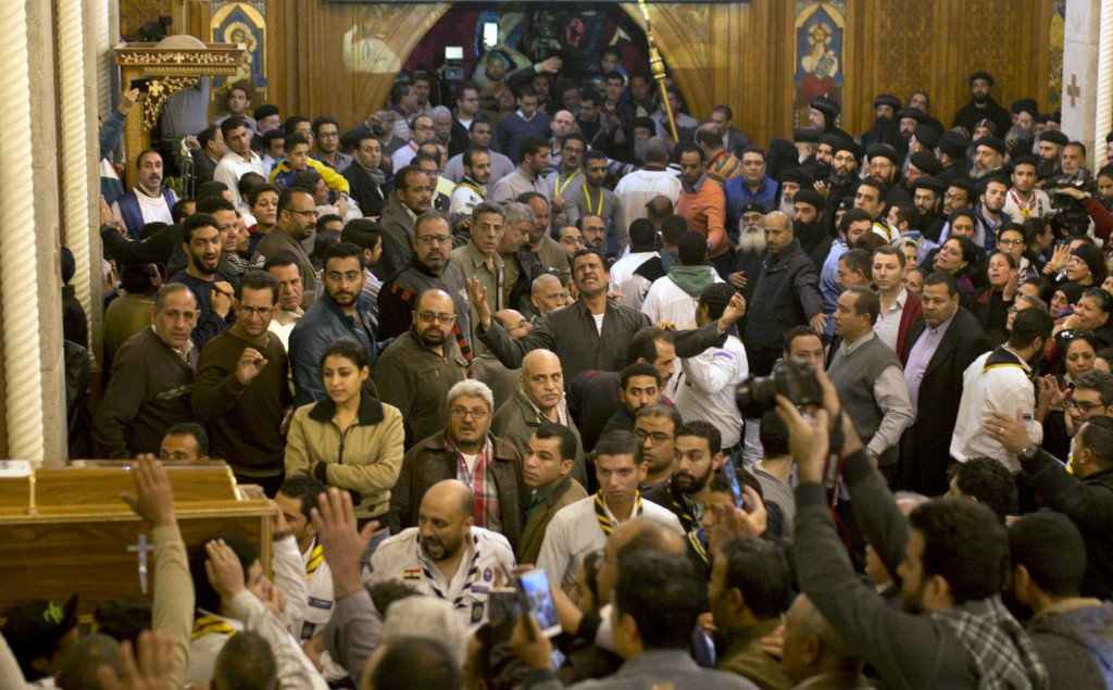 A relative of a of a Coptic Christian, who was killed during the attack on Mar Mina church, grieves during the funeral service of the victims in Cairo...
