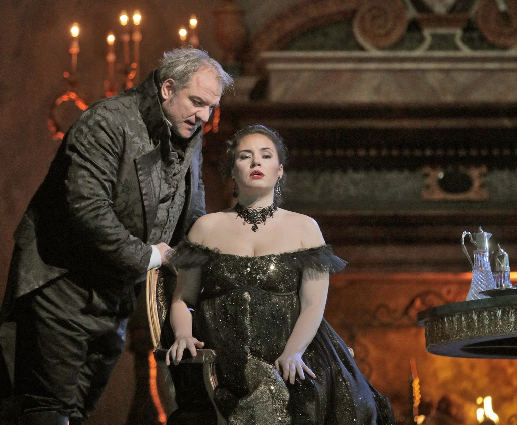 In this Dec. 21, 2017 photo provided by the Metropolitan Opera, Serbian born baritone Zeljko Lucic appears as Scarpia, left, and Sonya Yoncheva is Flo...