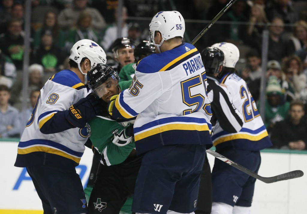 Dallas Stars center Gemel Smith (46) fights with St. Louis Blues right wing Scottie Upshall (9) and defenseman Colton Parayko (55) during the first pe...
