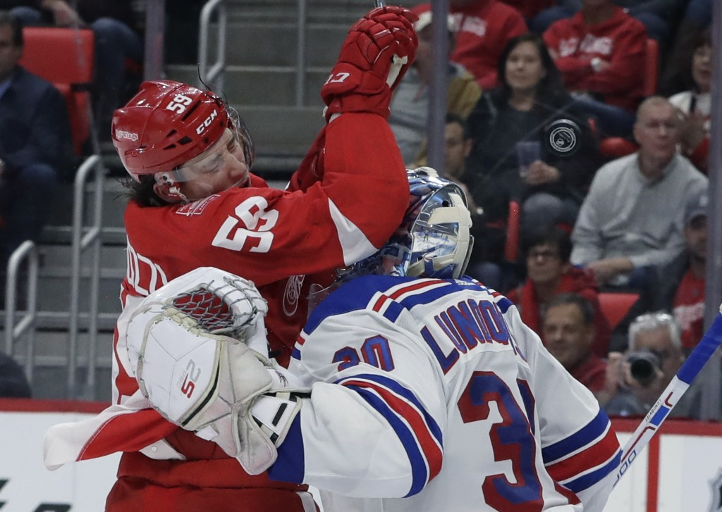 Detroit Red Wings left winger Tyler Bertuzzi (59) runs into New York Rangers goaltender Henrik Lundqvist (30) to avoid the puck during the second peri...