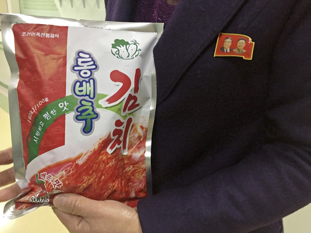 In this Dec. 20, 2017, photo, manager Paek Mi Hye holds a package of kimchi produced at the  Ryugyong Kimchi Factory on the outskirts of Pyongyang, No...