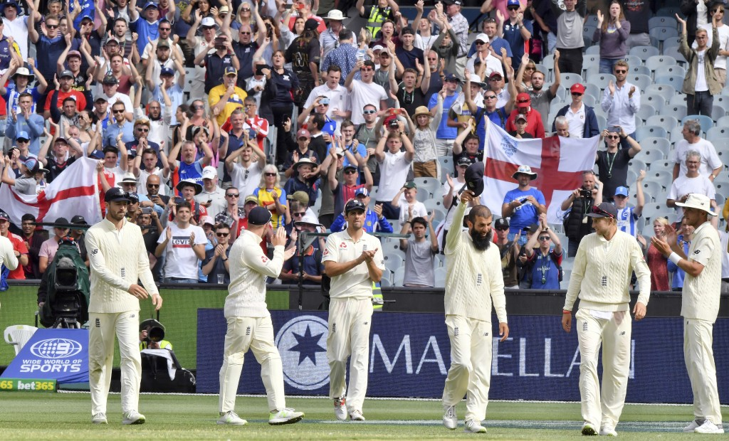"England players thank their support group the ""Barmy Army"" as they walk off the ground at the end of their Ashes cricket test match against Australia ..."