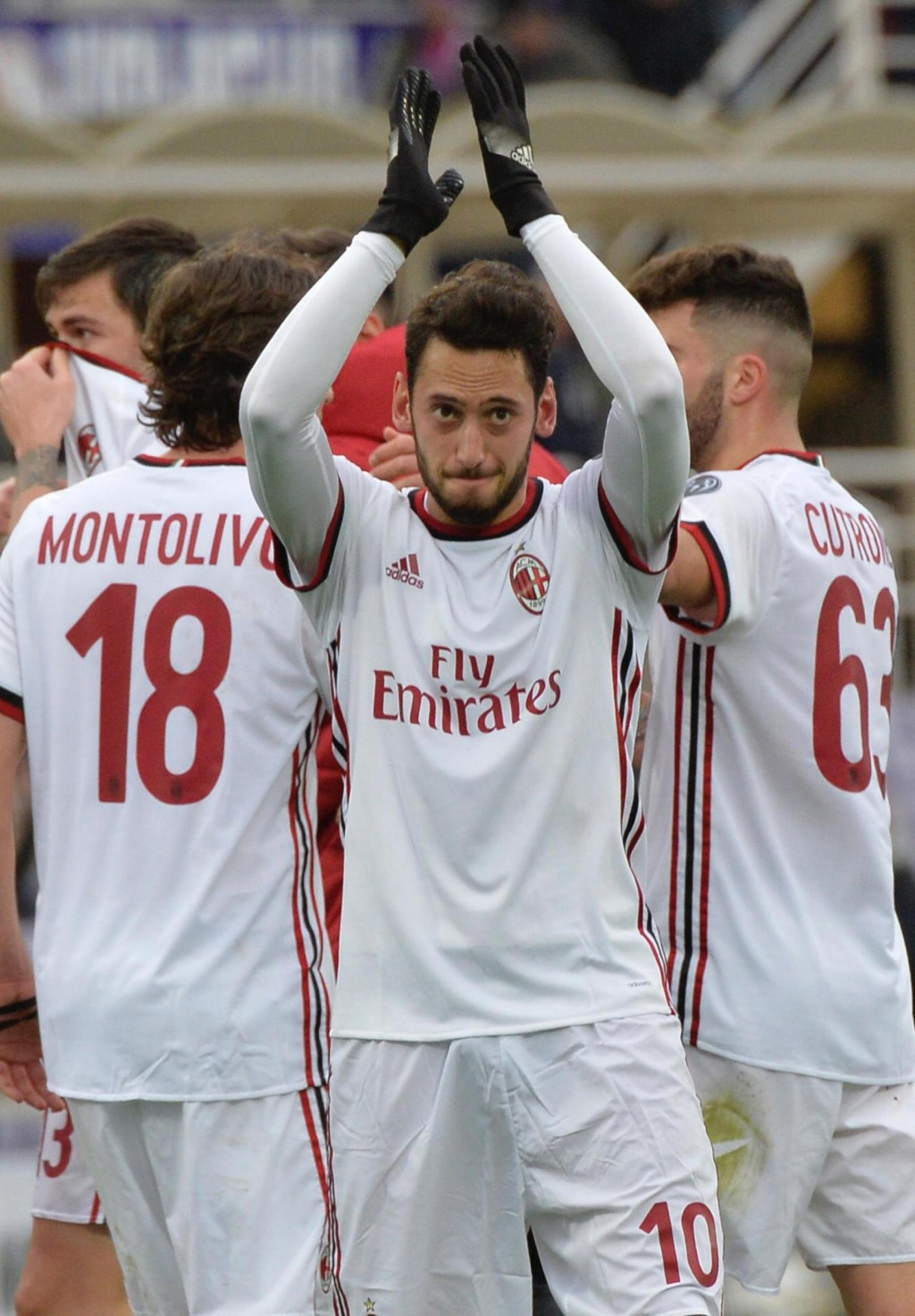 Milan's Hakan Calhanoglu celebrates after scoring the final equalizer during the Italian Serie A soccer match between Fiorentina and AC Milan at the A...