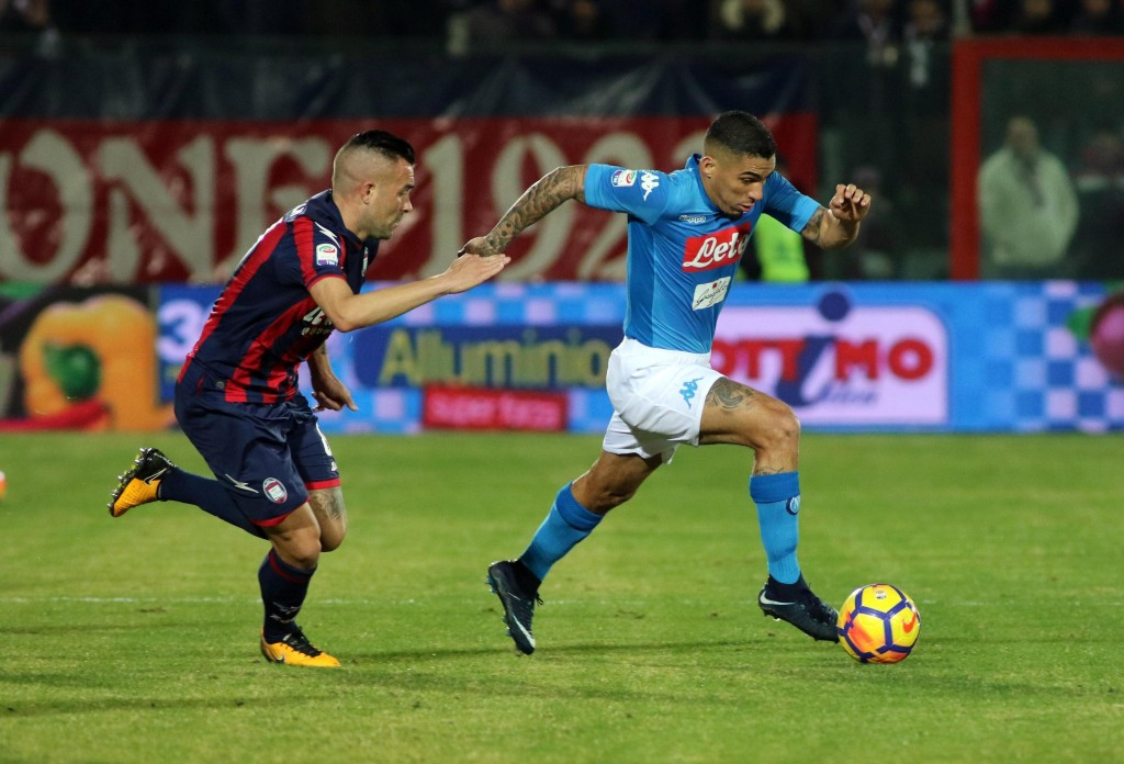 Napoli's Allan is chased by Crotone's Bruno Martella during the Italian Serie A soccer match between Crotone and Napoli at the Ezio Scida stadium in C...