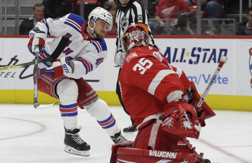Detroit Red Wings goaltender Jimmy Howard (35) deflects a shot by New York Rangers right wing Michael Grabner (40) during the first period of an NHL h...