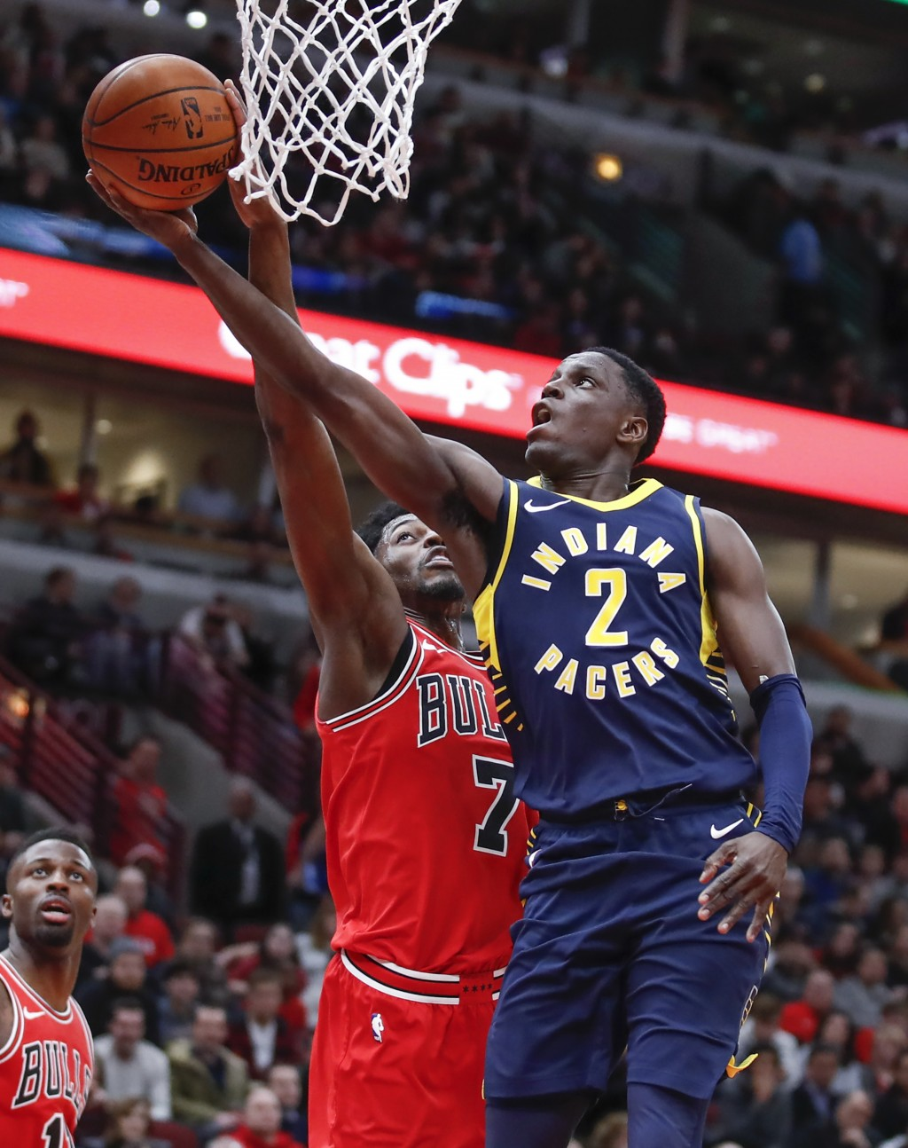 Indiana Pacers guard Darren Collison (2) goes to the basket against Chicago Bulls guard Justin Holiday (7) during the first half of an NBA basketball ...