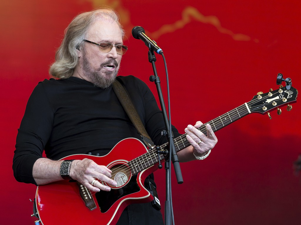 FILE - In this Sunday, June 25, 2017 file photo, singer Barry Gibb performs at the Glastonbury Festival at Worthy Farm, in Somerset, England. A Beatle...