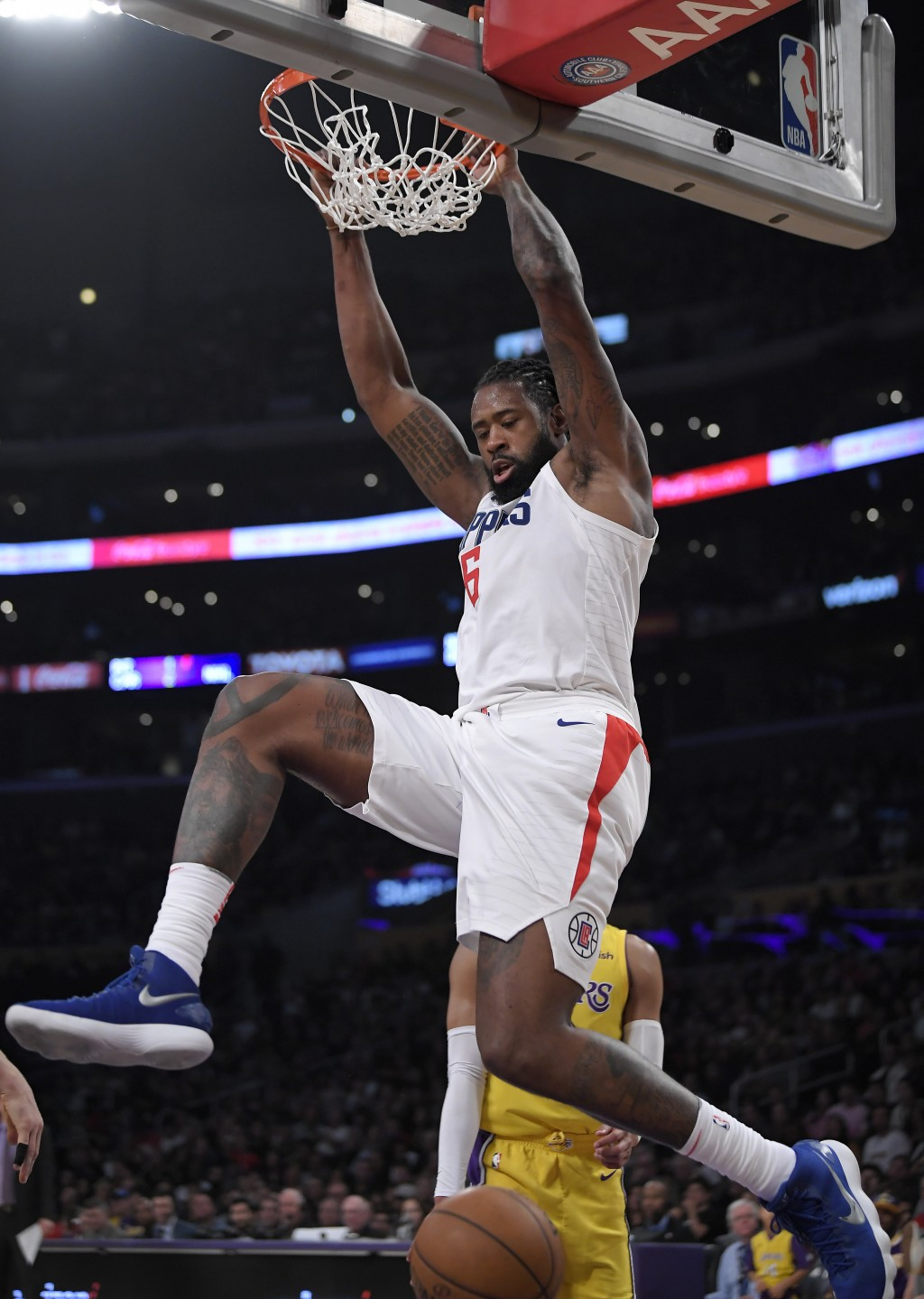 Los Angeles Clippers center DeAndre Jordan dunks during the first half of the team's NBA basketball game against the Los Angeles Lakers, Friday, Dec. ...