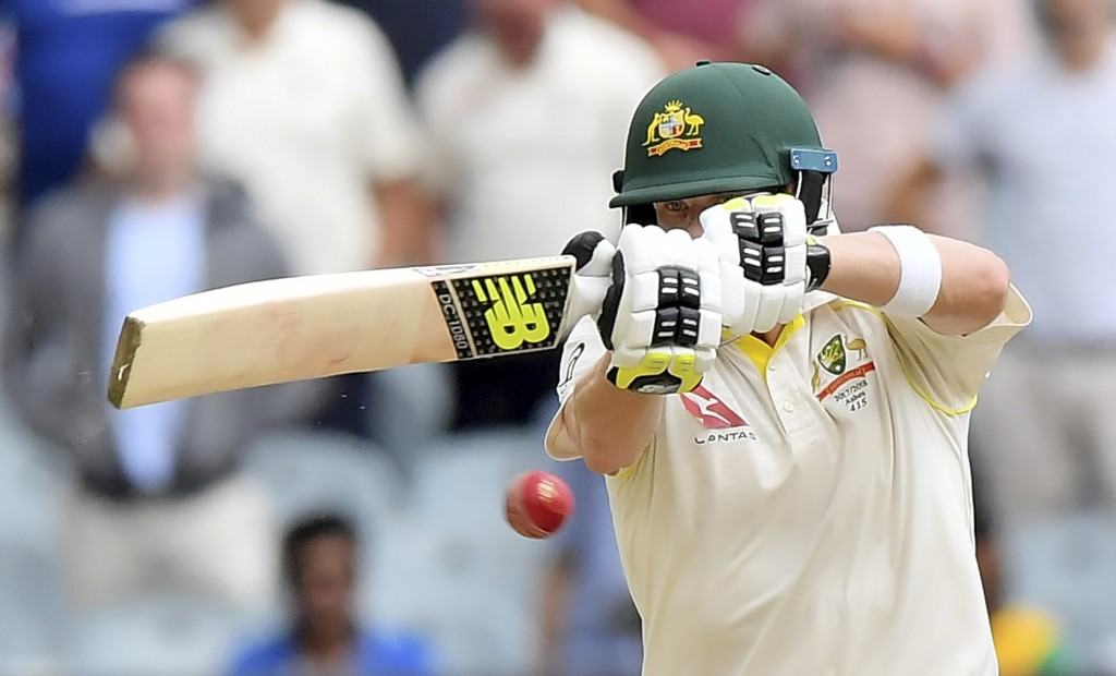 Australia's Steve Smith pulls a ball against England during the fifth day of their Ashes cricket test match in Melbourne, Australia, Saturday, Dec. 30...