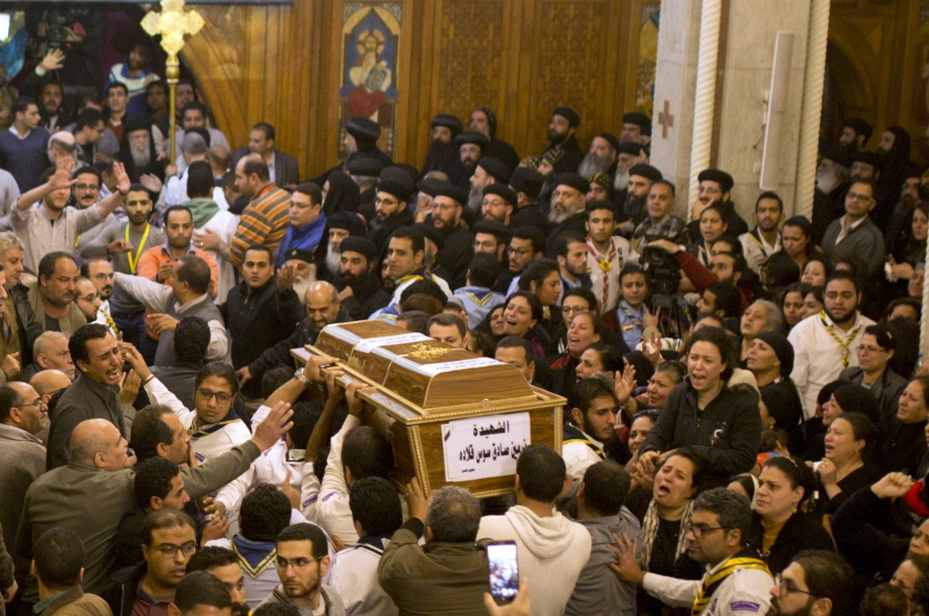 Relatives of Coptic Christians grieve as they carry the coffin of Nermin Sadek, one of the victims of the militants attack on Mar Mina church, during ...