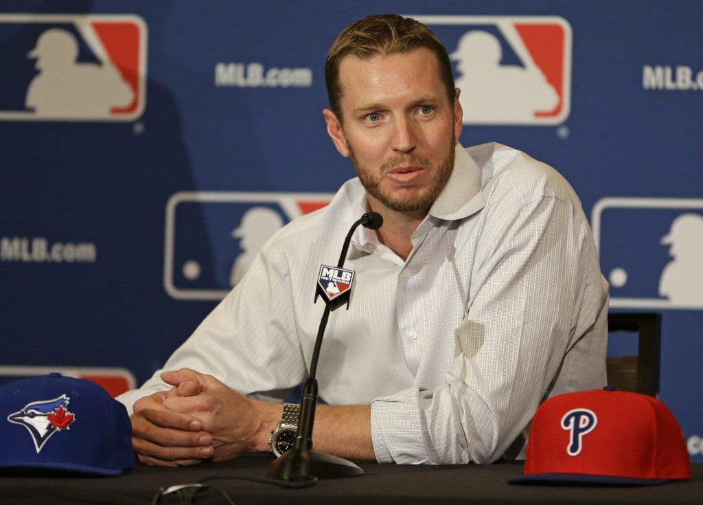 FILE - In this Dec. 9, 2013, file photo, two-time Cy Young Award winner Roy Halladay answers questions after announcing his retirement after 16 season...