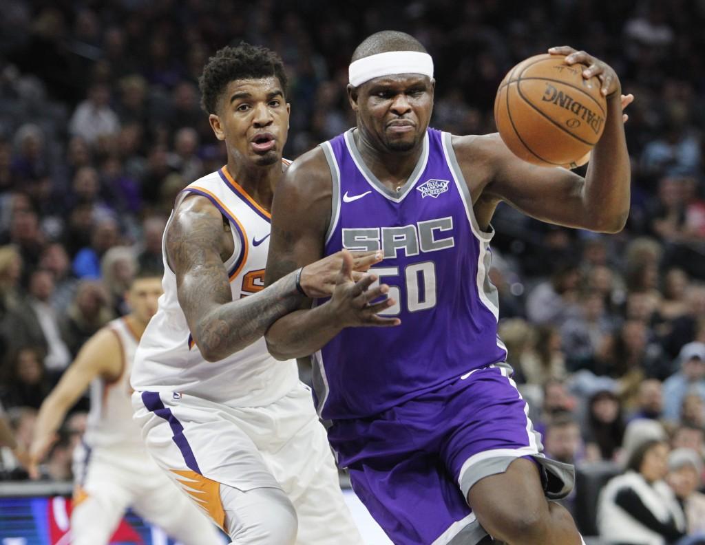 Sacramento Kings forward Zach Randolph (50) drives to the basket around Phoenix Suns forward Marquese Chriss (0) during the first half of an NBA baske...