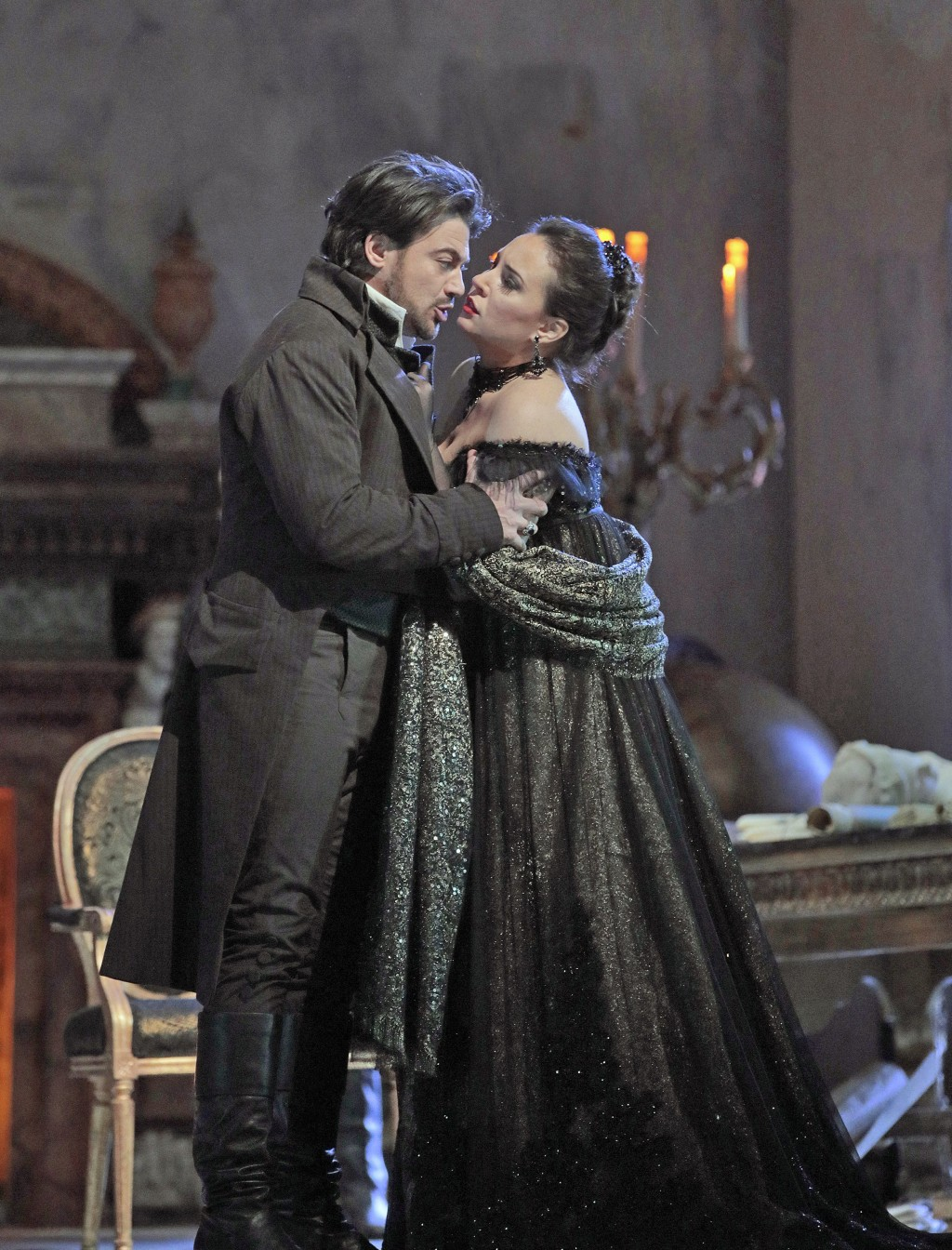 In this Dec. 21, 2017 photo provided by the Metropolitan Opera, Vittorio Grigolo, left, appears as the painter Mario Cavaradossi and Sonya Yoncheva is...
