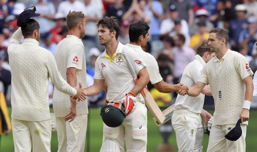 Australia's Mitchell Marsh, third left, shakes hands with England players at the end of their Ashes cricket test match against Australia in Melbourne,...