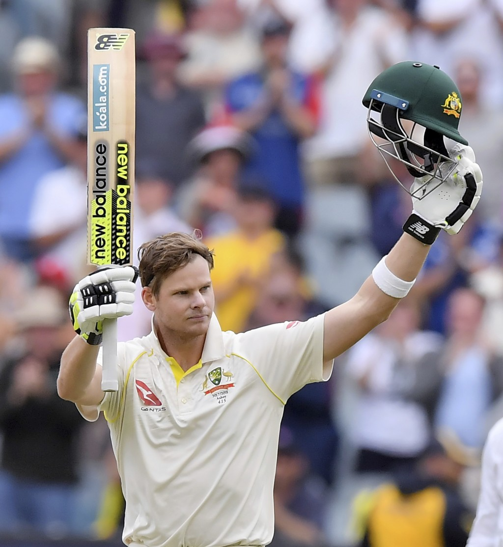 Australia's Steve Smith celebrates making 100 runs against England during the fifth day of their Ashes cricket test match in Melbourne, Australia, Sat...