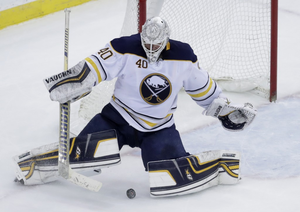 Buffalo Sabres goaltender Robin Lehner (40), of Sweden, blocks a shot by the New Jersey Devils during overtime of an NHL hockey game, Friday, Dec. 29,...