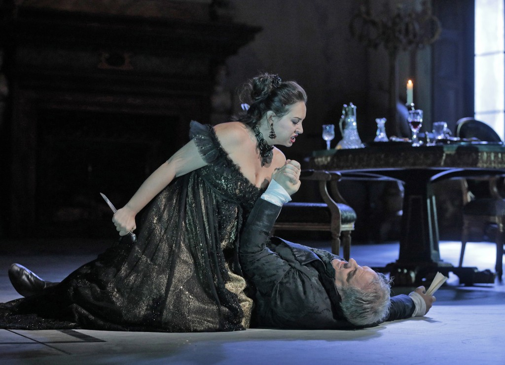 In this Dec. 21, 2017 photo provided by the Metropolitan Opera, Sonya Yoncheva, left, as Floria Tosca, wields a knife while threatening to stab Zeljko...