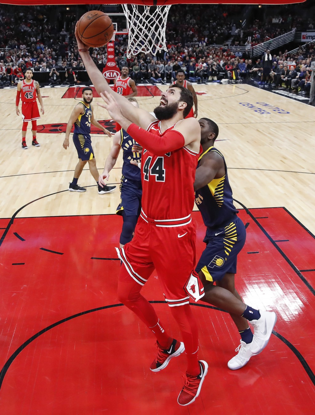 Chicago Bulls forward Nikola Mirotic, center, goes to the basket against Indiana Pacers forward Alex Poythress, right, during the first half of an NBA...