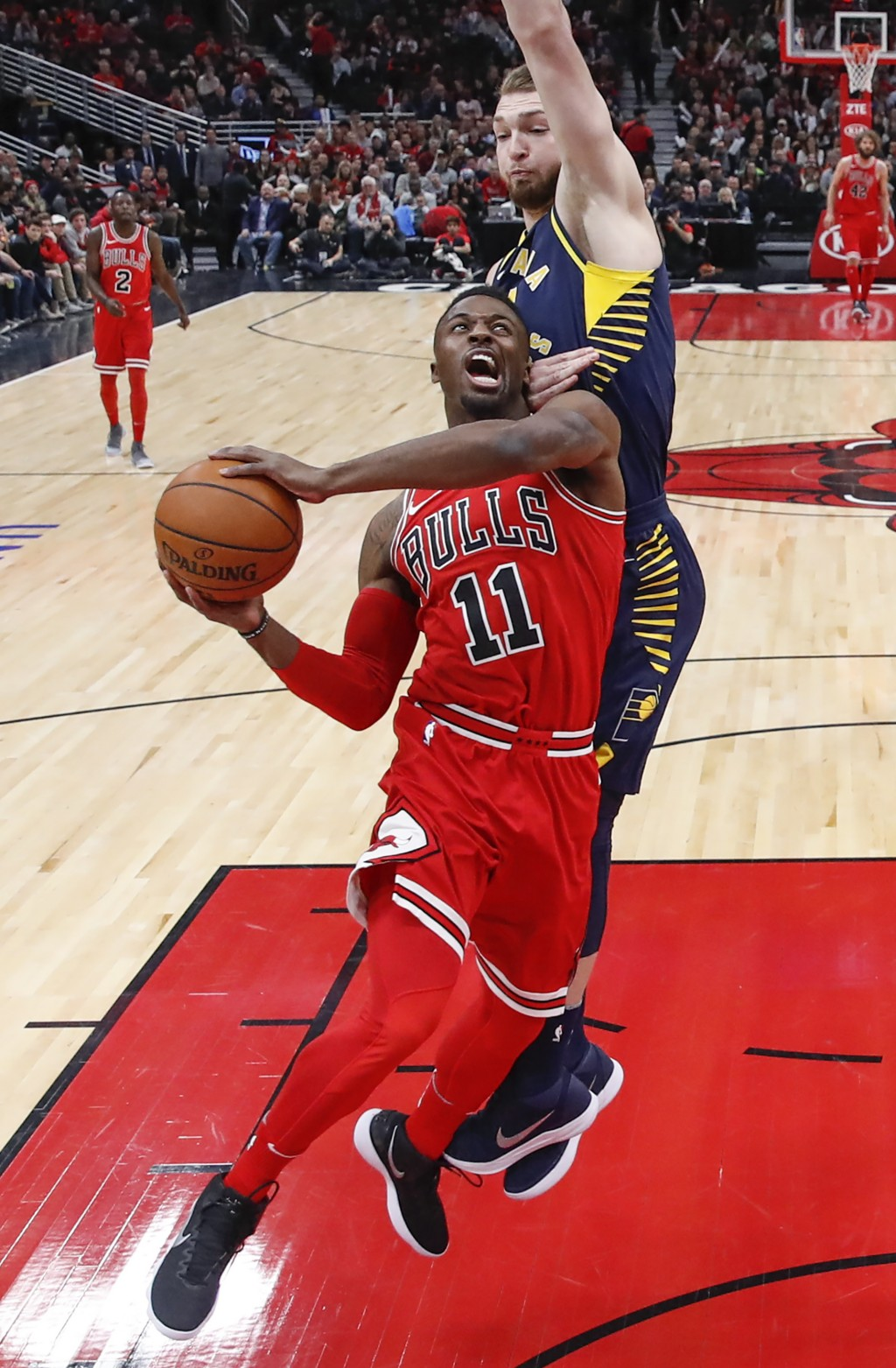 Chicago Bulls guard David Nwaba, front, goes to the basket against Indiana Pacers center Domantas Sabonis, back, during the first half of an NBA baske...