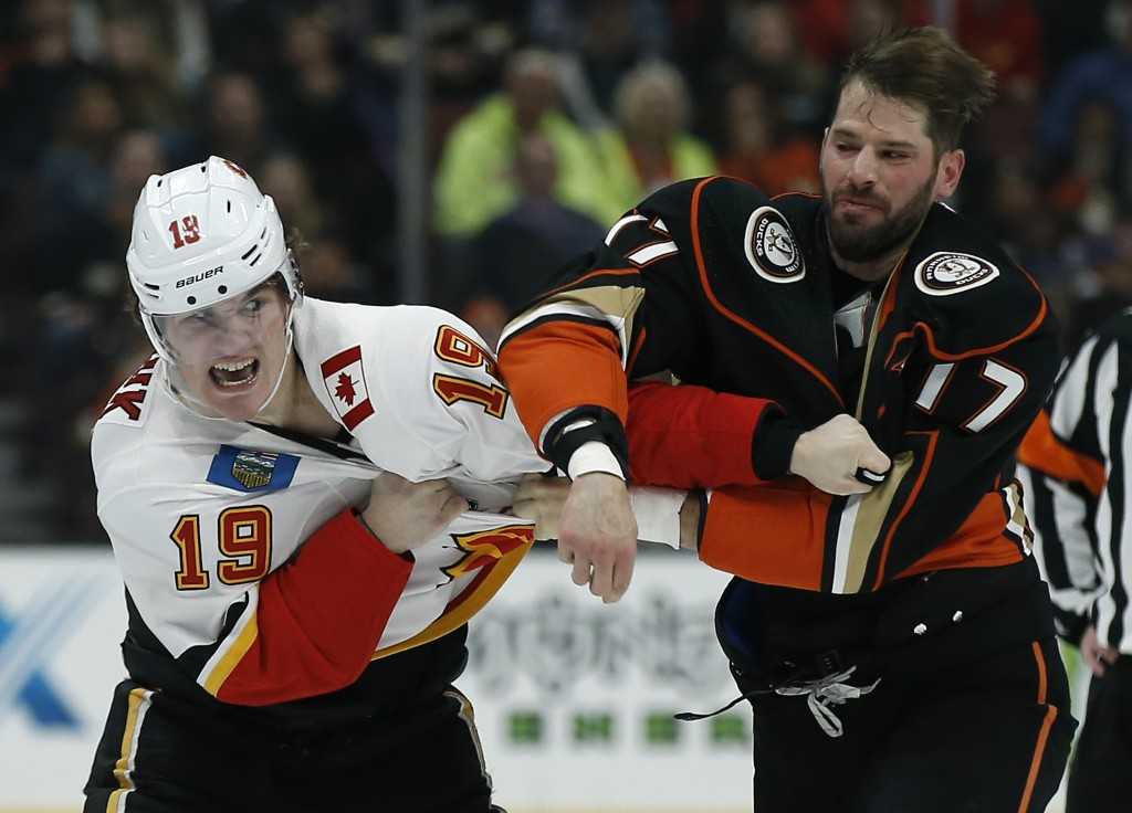 Calgary Flames left wing Matthew Tkachuk, left, fights with Anaheim Ducks center Ryan Kesler during the first period of an NHL hockey game in Anaheim,...