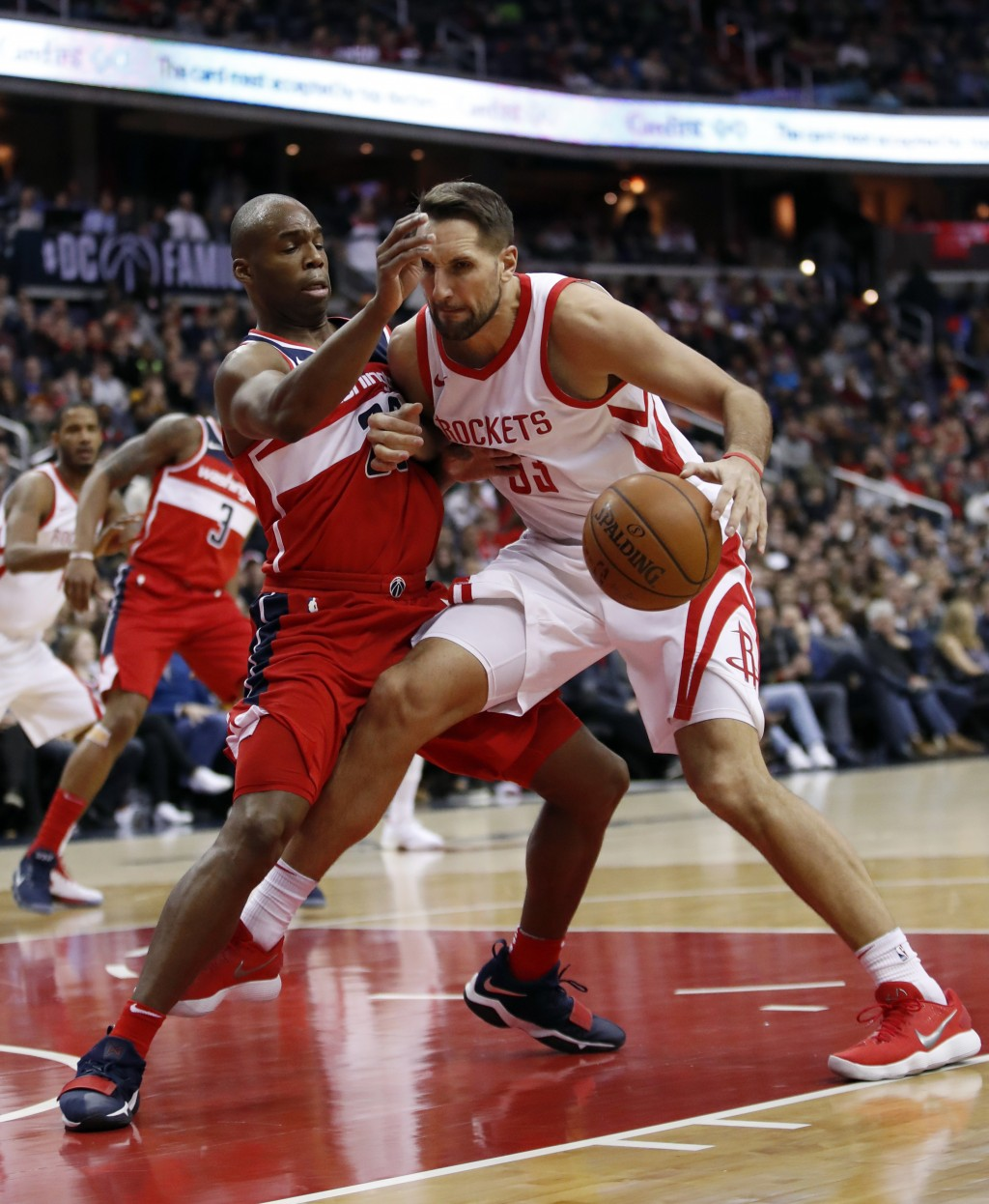 Washington Wizards guard Jodie Meeks, left, guards Houston Rockets forward Ryan Anderson during the first half of an NBA basketball game Friday, Dec. ...