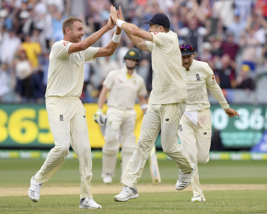 England's Stuart Broad, left, celebrates with teammate James Anderson after taking the wicket of Australia's Shaun Marsh, caught out for 4 runs, durin...