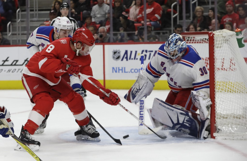 Detroit Red Wings left wing Justin Abdelkader (8) shoots the puck towards New York Rangers goaltender Henrik Lundqvist (30) during the second period o...