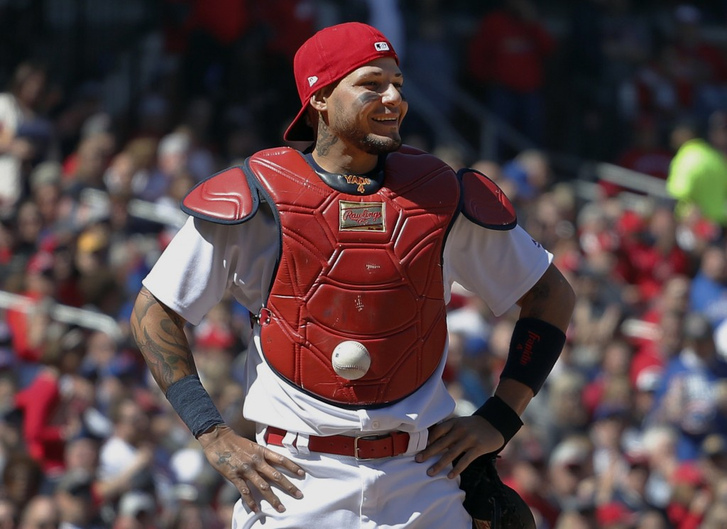 FILE - In this April 6, 2017, file photo, St. Louis Cardinals catcher Yadier Molina stands with his hands on his hips as a ball is somehow stuck to hi...