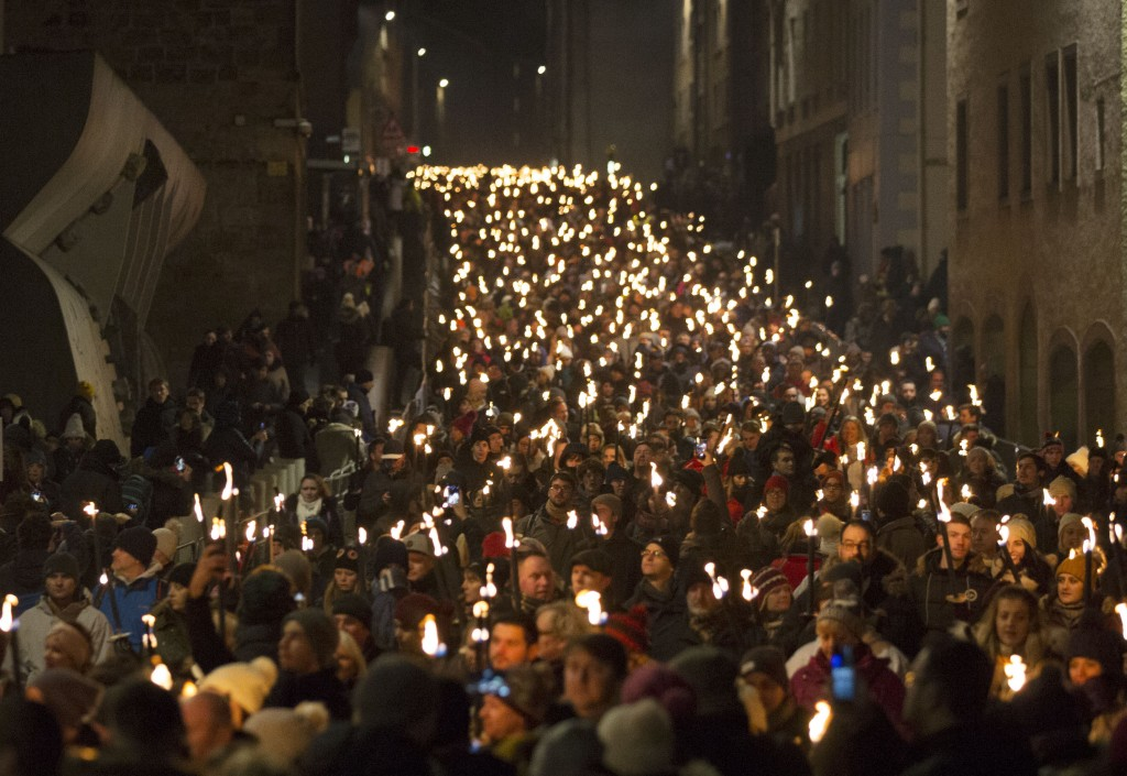 The torchlight procession which marks the opening of city's New Year celebrations, makes its way through Edinburgh, Saturday Dec. 30, 2017. Torchbeare