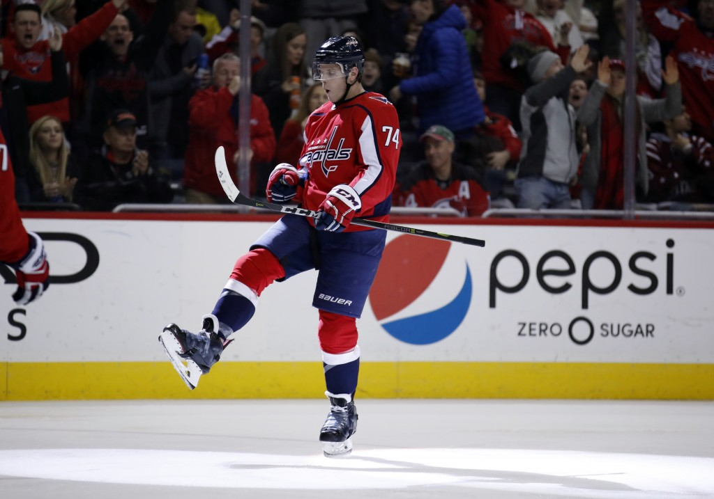 Washington Capitals defenseman John Carlson celebrates his goal in the second period of an NHL hockey game against the New Jersey Devils, Saturday, De...