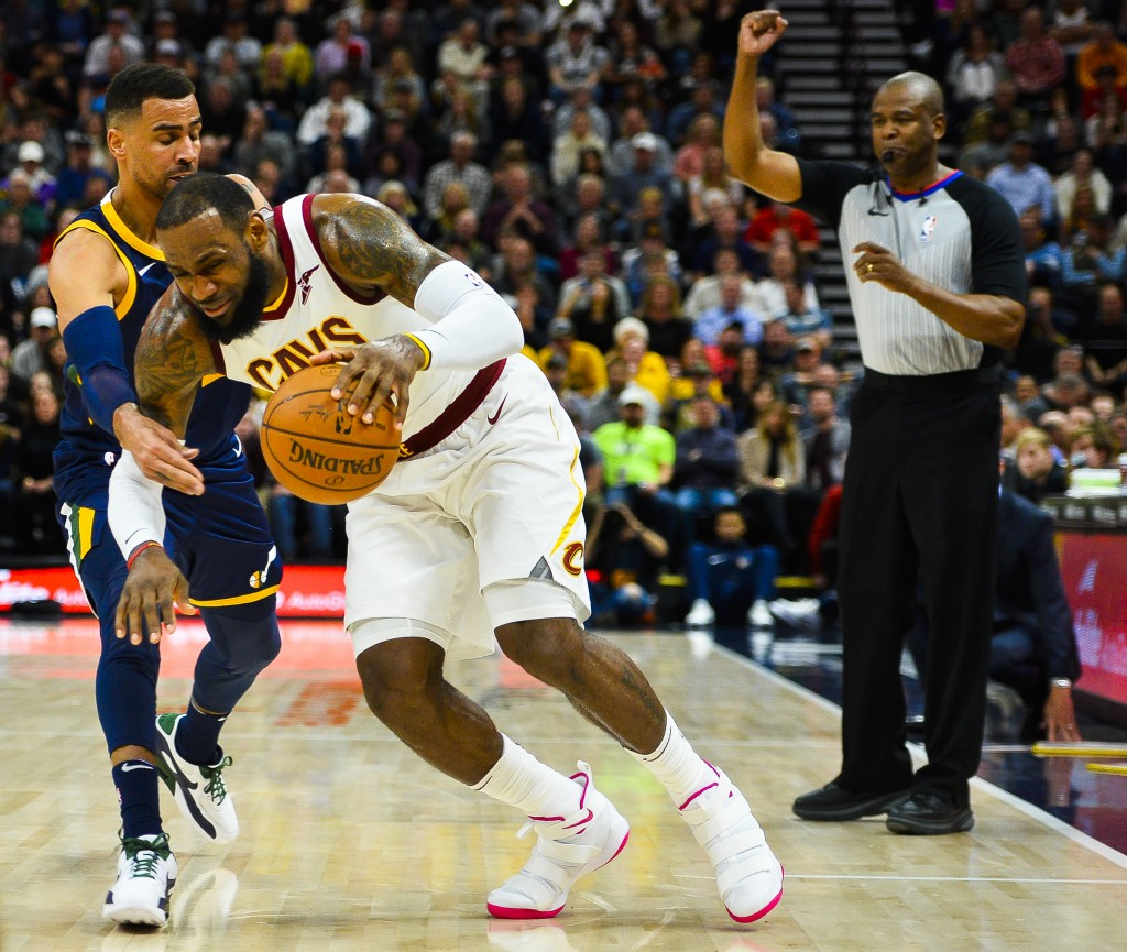 Utah Jazz forward Thabo Sefolosha, left, guards against Cleveland Cavaliers forward LeBron James, right, in the first half of an NBA basketball game S...