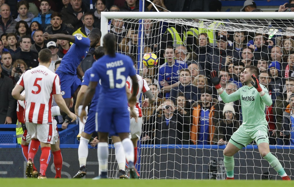 Chelsea's Antonio Rudiger, top left, heads the ball and scores his side's first goal during their English Premier League soccer match between Chelsea ...
