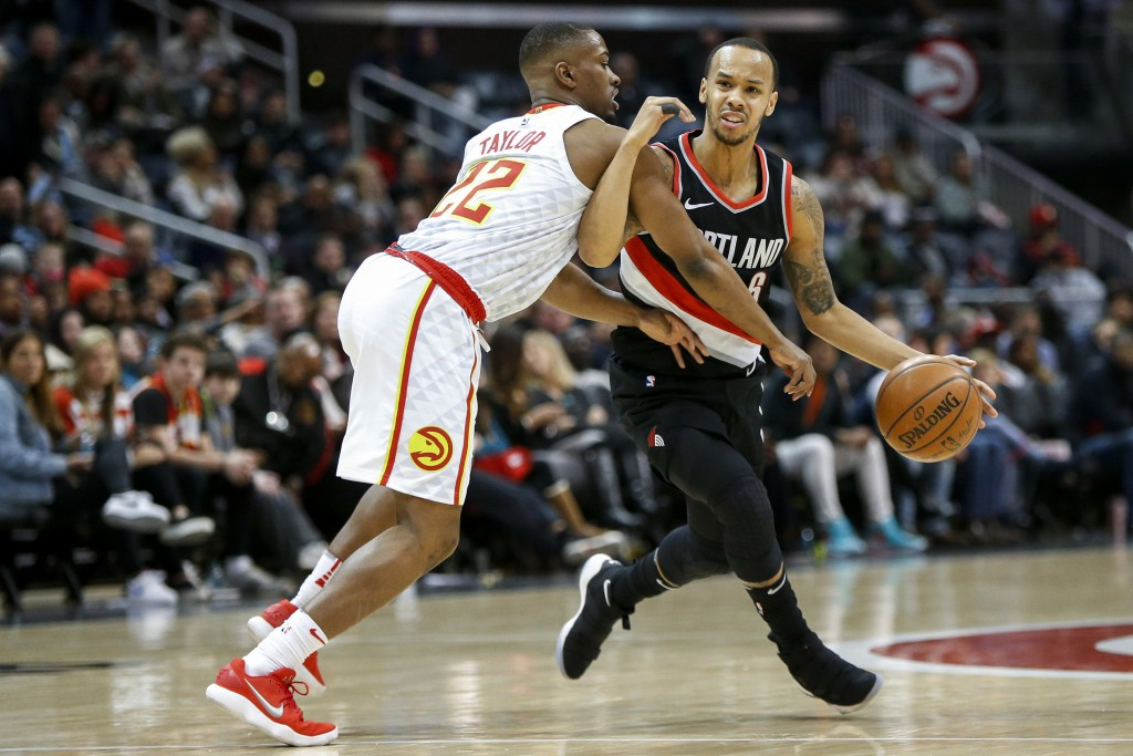 Portland Trail Blazers guard Shabazz Napier (6) is defended by Atlanta Hawks guard Isaiah Taylor (22) in the first half of an NBA basketball game, Sat...