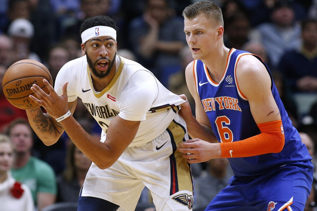 New Orleans Pelicans forward Anthony Davis (23) drives against New York Knicks forward Kristaps Porzingis (6) during the first half of an NBA basketba...
