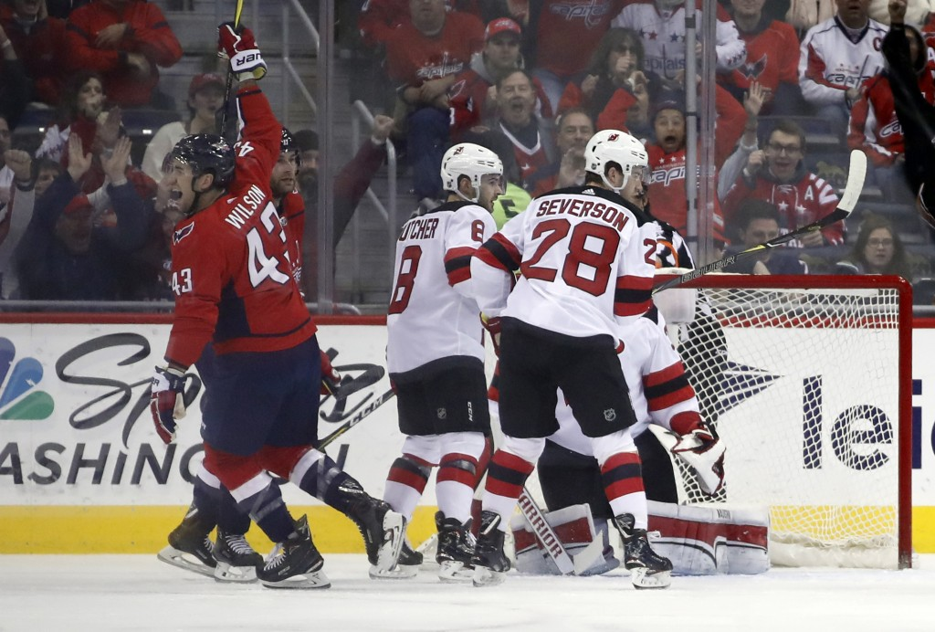 Washington Capitals right wing Tom Wilson (43) celebrates his goal in the first period of an NHL hockey game against the New Jersey Devils, Saturday, ...