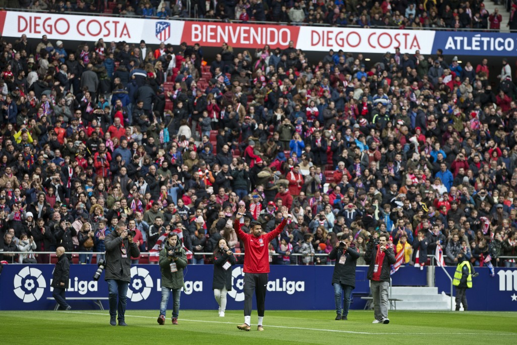 Diego Costa waves to fans during his official presentation for Atletico Madrid at the Wanda Metropolitano stadium in Madrid, Spain, Sunday, Dec. 31, 2...
